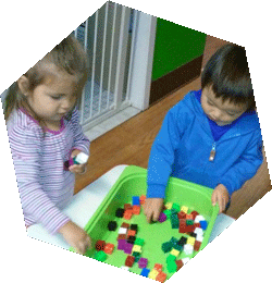 children playing with blocks at Happy Bees Daycare