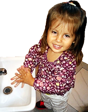 child washing her hands at Happy Bees Daycare